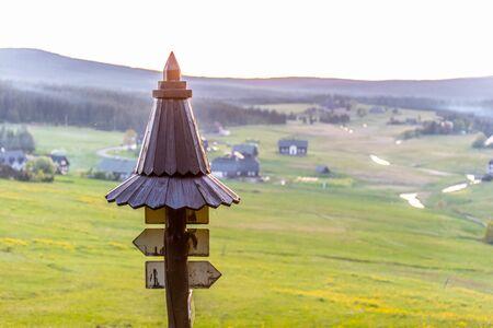 Wooden tourist signpost in Jizera Mountains, Czech Republic. Standard-Bild