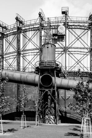 Renovated gasholder in the industrial zone, Dolni Vitkovice, Ostrava, Czech Republic. Black and white image. Banque d'images - 144075697
