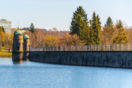 Mseno Reservoir with old stone dam on sunny day. Jablonec nad Nisou, Czech Republic.