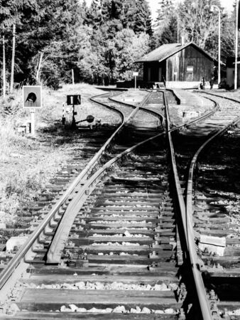 Small regiona train station in Czech republic. Black and white image. Imagens