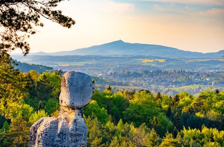 Landscape of Bohemian Paradise, Czech: Cesky raj, with sandstone rock formations and Jested Mountain on the background, Czech Republic,