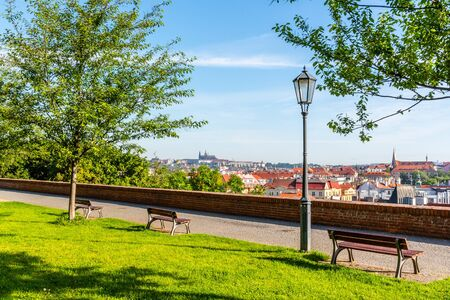 View of Prague Castle from Vysehrad with lush green spring trees, Prague, Czech Republic.