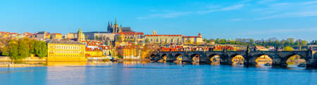 Panoramic view of Prague Castle and Charles Bridge on sunny spring morning, Praha, Czech Republic.