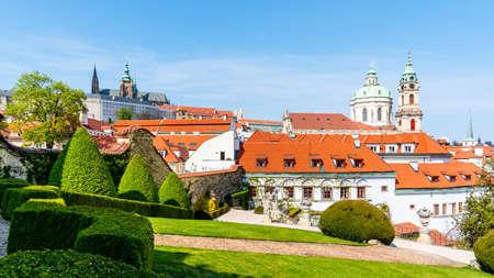 Prague Castle and St Nicholas Church in Lesser Town of Prague. Sunny spring day view from Vrtba Garden. Prague, Czech Republic. Standard-Bild