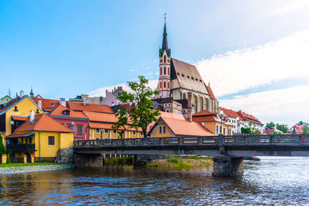 St Vitus church in the middle of historical city centre. View from Vltava River. Cesky Krumlov, Southern Bohemia, Czech Republic.