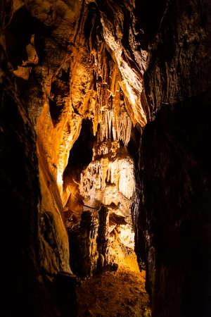 Illuminated picturesque karst rock formations in Balcarka Cave, Moravian Karst, Czech: Moravsky Kras, Czech Republic.