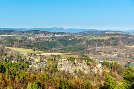 Aerial view of sandstone ridge with Pantheon - Vranov castle ruins above Mala Skala. Giant mountains on the background. Czech Republic