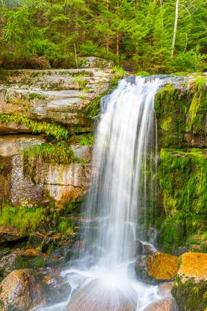 Waterfall of Jedlova. Small waterfall with mossy granite rocks. Jizera Mountains, Northern Bohemia, Czech Republic