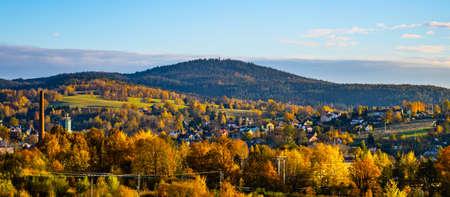 Autumn hilly landscape at sunset time. Colorful trees and meadows around Vratislavice nad Nisou near Liberec, Czech Republic Reklamní fotografie