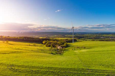 Wind turbine in green rural landscape from above Archivio Fotografico