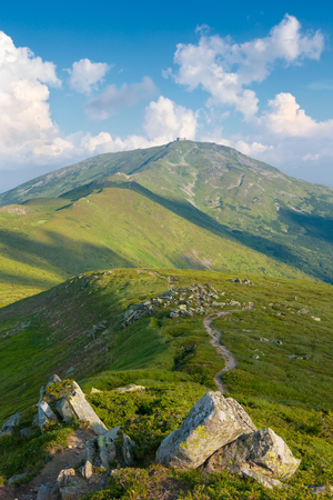Carpathian Mountains, rocks, trail in the morning with blue sky and beautiful clouds photo