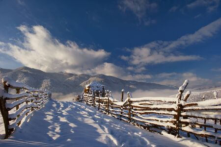Carpathian mountains covered with snow and beautiful sunshine lit Stock Photo