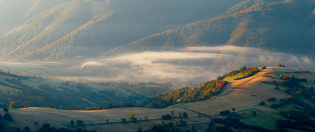 fog in the mountains, early light, autumn