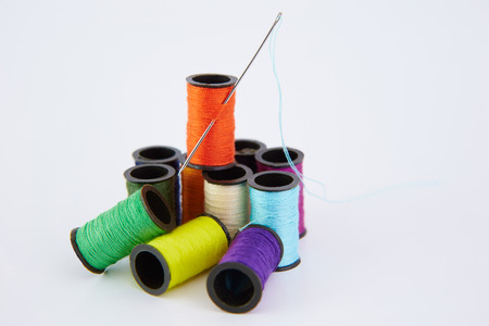 different colors of small coils of threads,