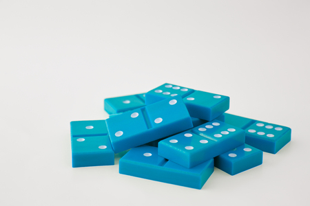 Dominoes in plain background, large pile of dominoes