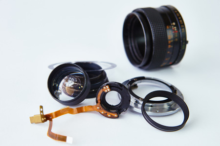 disassembled lens on a white background