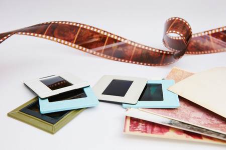 film and slides on a white background, in a beautiful composition Stockfoto