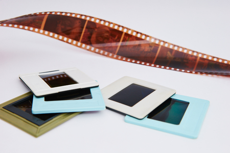 film and slides on a white background, in a beautiful composition