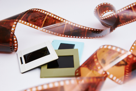 film and slides on a white background, in a beautiful composition Archivio Fotografico