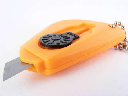 Orange box knife against a white background. Stok Fotoğraf