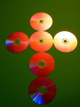 necessarily: A christian cross made by arranging CDs suggesting that science (technology) and religion are not necessarily mutually exclusive. Stock Photo