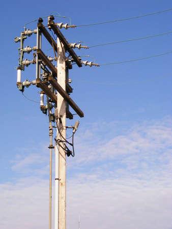 An electrical power pole with capacitors. Фото со стока