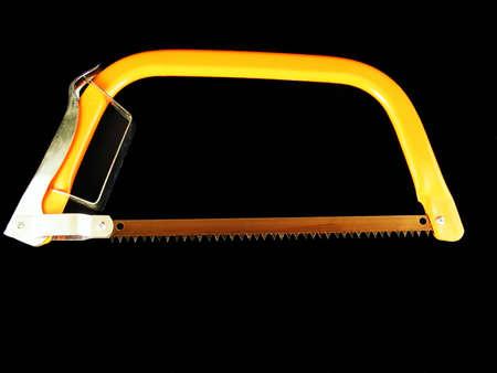 An orange hacksaw against a black background.