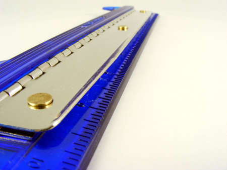 paper puncher: A blue plastic 3-hole paper puncher against a white background.