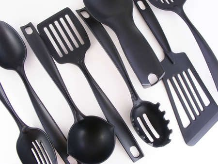 A set of kitchen utensils against a white background. Imagens