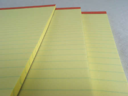 Three canary yellow legal pads. photo