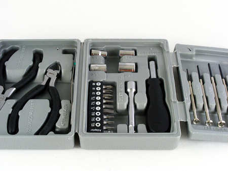 home repairs: Part of a small toolkit for do it yourself home repairs which includes screwdrivers and pliers.