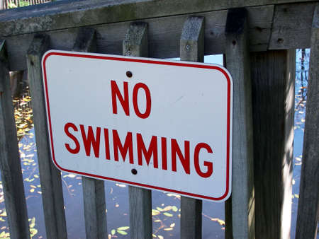 A sign reading no swimming. Banco de Imagens