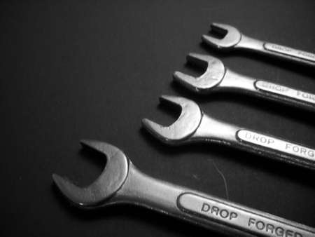 A set of four open end wrenches bearing the words