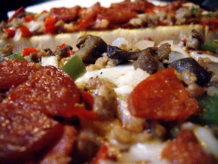 A close-up shot of cooked pizza toppings. Stock Photo