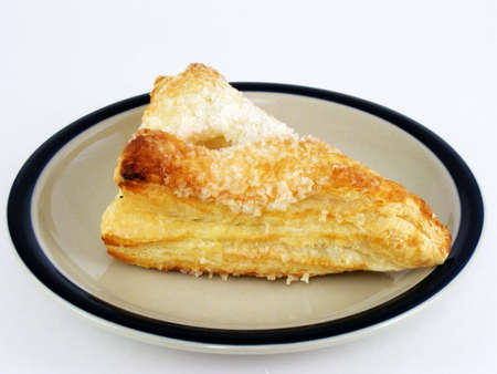 turnover: A fruit turnover on a plate.