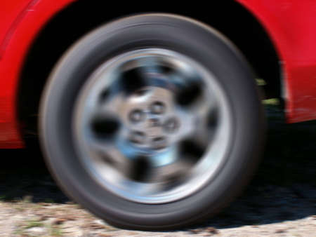 A close-up of a car wheel in motion. photo