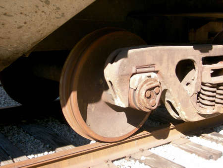 overexposed: Train wheels close up. Overexposed to give the sense of age and heat. Stock Photo