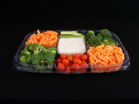 A vegetable snack tray with dip, carrots, broccoli, celery and tomatoes. Stock Photo - 2402970