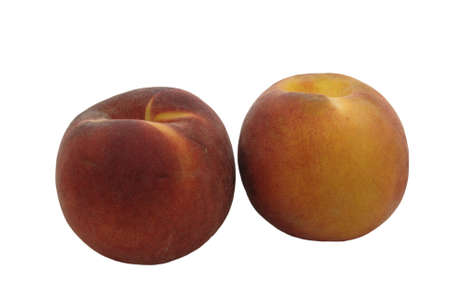 A pair of peaches isolated against a white background.