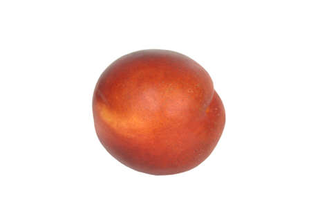 A single nectarine isolated against a white background. Imagens