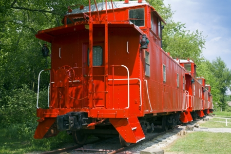 caboose: Red Caboose on Tracks