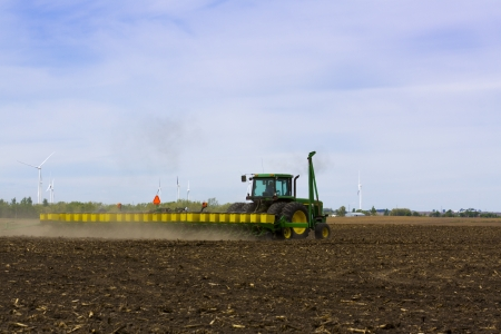 seed drill: Tractor with Seed Drill Sowing on Field Stock Photo