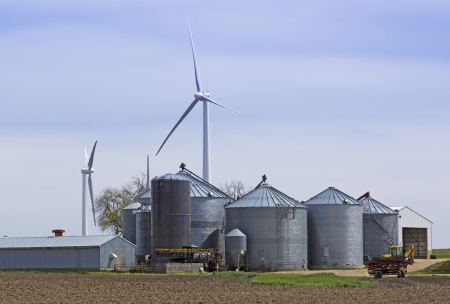 Grain Silos Farm with Electric Windmill Stock Photo - 17359399