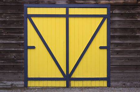 blue yellow wooden barn door photo