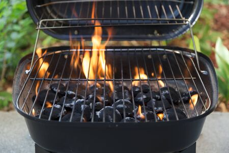 balcony: charcoal grill and flames close up