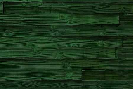 green lines: deep green wooden texture background close up