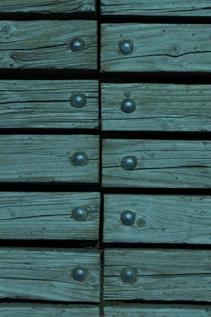 blue wooden texture background with rivets close up photo