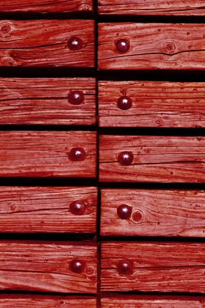 rivets: red wooden texture background with rivets close up Stock Photo