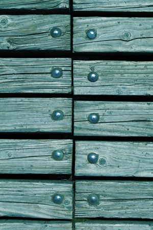 rivets: blue wooden texture background with rivets close up Stock Photo