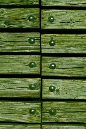 rivets: washed green wooden texture background with rivets close up Stock Photo